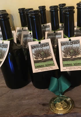 Unopened dark glass bottles of award winning cider from Windfall Orchard in Cornwall Vermont